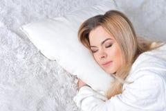Beautiful blonde girl sleeping Stock Photo