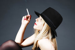 Beautiful blonde girl smoking Stock Photo