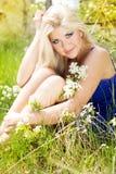 Beautiful blonde girl. Spring time Stock Image