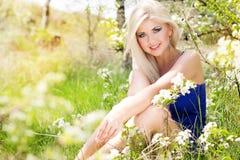 Beautiful blonde girl. Spring time Stock Photos