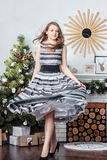 Beautiful blonde girl standing around a Christmas Royalty Free Stock Images