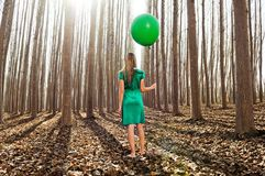 Beautiful blonde girl standing in the forest Royalty Free Stock Image