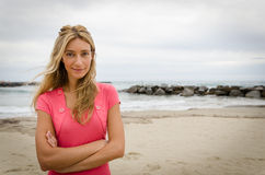 Beautiful blonde girl standing in front of the beach Royalty Free Stock Photography