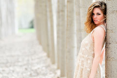 Beautiful blonde girl, standing in a poplar forest Royalty Free Stock Photography