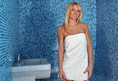 Beautiful blonde girl in steam room stock images