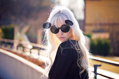 Beautiful blonde girl in sunglassses outdoors Royalty Free Stock Photos