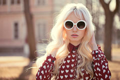 Beautiful blonde girl in sunglassses outdoors Royalty Free Stock Images