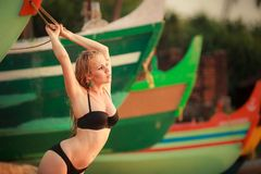 Beautiful blonde girl in swimming suit Royalty Free Stock Photos