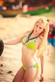 Beautiful blonde girl in swimming suit Stock Photo