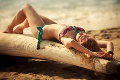 Beautiful blonde girl in swimming suit Stock Images