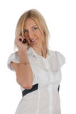 Beautiful blonde girl talking on phone and smiling Stock Image