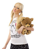 Beautiful blonde girl with teddy bear Royalty Free Stock Photography