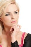 Beautiful blonde girl thinking Stock Photo
