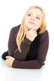 Beautiful blonde girl thinks Stock Photos
