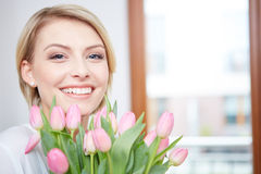 Beautiful blonde girl with tulips Stock Photo