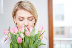 Beautiful blonde girl with tulips Royalty Free Stock Photography