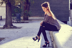 Beautiful blonde girl in urban background Royalty Free Stock Photos