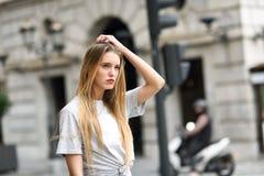 Beautiful blonde girl in urban background Stock Image