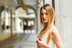 Beautiful blonde girl in urban background Stock Photo