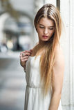 Beautiful blonde girl in urban background Royalty Free Stock Photos