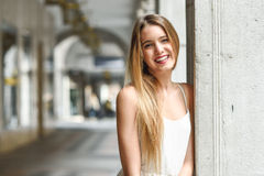 Beautiful blonde girl in urban background Royalty Free Stock Photography