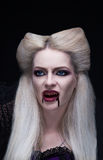 Beautiful blonde girl vampire is angry Royalty Free Stock Images
