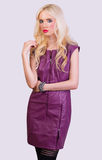 Beautiful blonde girl in violet dress Royalty Free Stock Image