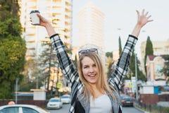 Beautiful blonde girl walking around city Royalty Free Stock Photos