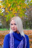Beautiful blonde girl walking in the park on autumn day Stock Photography