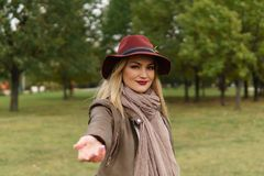 Beautiful blonde girl walking in the park royalty free stock photography