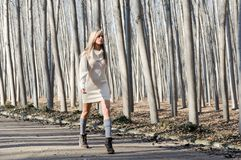 Beautiful blonde girl walking in a rural road Royalty Free Stock Photos