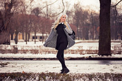 Beautiful blonde girl walking on the street Royalty Free Stock Images