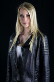 Beautiful blonde girl wearing a black leather jacket Royalty Free Stock Images