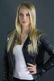 Beautiful blonde girl wearing a black leather jacket Stock Photography
