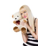 Beautiful blonde girl wearing pajamas with teddy bear Royalty Free Stock Photo