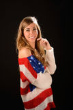 Beautiful blonde girl wearing a sweater with the flag of United. Portrait of a beautiful blonde girl wearing a sweater with the flag of United States Royalty Free Stock Photo
