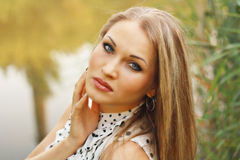 Beautiful blonde girl  in white gown Royalty Free Stock Images