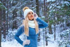 Beautiful blonde girl in the white hat and gloves stock photo