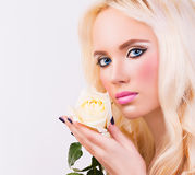 Beautiful blonde girl with white rose Stock Photo