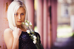 Beautiful blonde girl with white rose Royalty Free Stock Photography