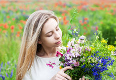Beautiful blonde girl with wildflowers Royalty Free Stock Photo