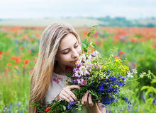 Beautiful blonde girl with wildflowers Royalty Free Stock Photos