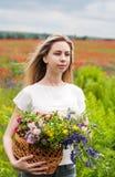 Beautiful blonde girl with wildflowers Stock Photo