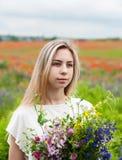 Beautiful blonde girl with wildflowers Stock Photos