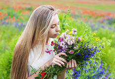 Beautiful blonde girl with wildflowers Royalty Free Stock Images