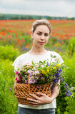 Beautiful blonde girl with wildflowers Royalty Free Stock Image