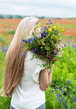 Beautiful blonde girl with wildflowers Stock Images