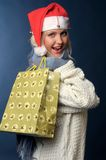 Beautiful blonde girl in winter clothes, santa hat Royalty Free Stock Photos