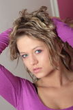 Beautiful blonde girl (woman) in a violet dress Royalty Free Stock Photos