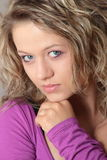 Beautiful blonde girl (woman) in a violet dress Stock Image
